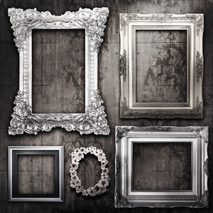 Grungy Room With Silver Frames And Victorian Wallpaper